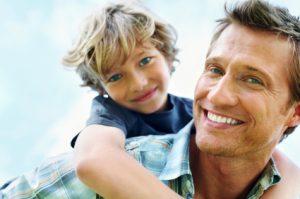 boy on father's back - Child Custody Missouri